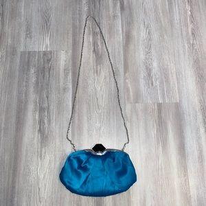NWOT le chateau blue clutch purse